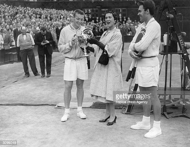 Marina Duchess of Kent presents the Wimbledon men's singles trophy to Tony Trabert of the USA after he beat Kurt Nielsen of Denmark in three sets