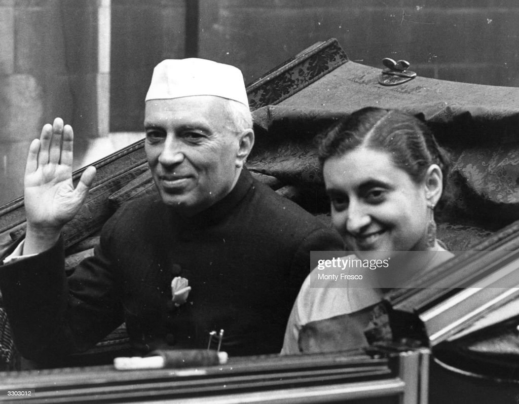 India's first Prime Minister Jawaharlal Nehru with his daughter Indira Gandhi future Prime Minister They are being driven through the streets of...
