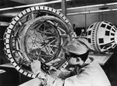 A technician prepares to wire together the components of the Bell System's Telstar experimental communications satellite shortly before its launch...