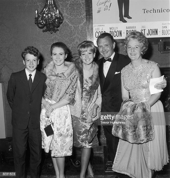 The Mills family at the Plaza theatre where they watched the premiere of 'Come Blow Your Horn' starring Frank Sinatra Left to right Jonathon Juliet...