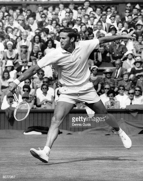 Australian tennis player Roy Emersonin action during the semifinals of the men's singles at the Wimbledon Lawn Tennis Championships
