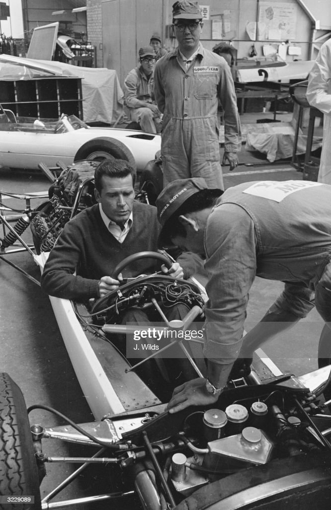 American actor James Garner at the wheel of a racing car during the filming of John Frankenheimer's 'Grand Prix' on location at the Cooper Car...