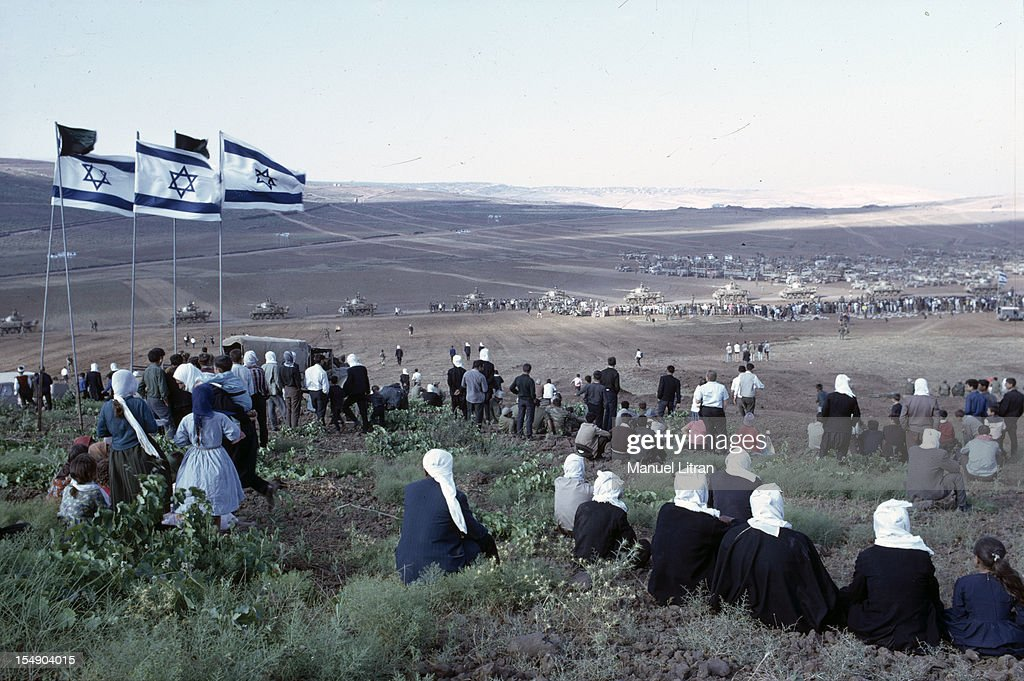 July 1967 after the 'Six Day War' Israel tripled its surface area The new frontier of the Hebrew state The people on the hill observe Israeli tanks...