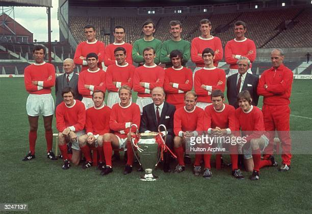 Sir Matt Busby poses with the Manchester United team and the European Cup