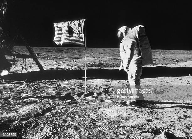 American astronaut Edwin 'Buzz' Aldrin on the surface of the moon next to the American flag during the NASA Apollo 11 mission Prints from Aldrin's...
