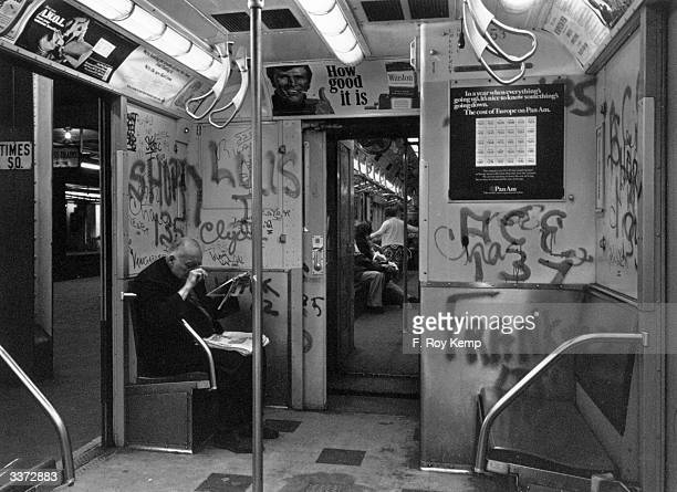 Graffiti covers the walls of an IRT carriage in the New York subway