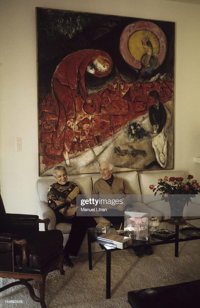 July 1973, the painter <a gi-track='captionPersonalityLinkClicked' href=/galleries/search?phrase=Marc+Chagall&family=editorial&specificpeople=214176 ng-click='$event.stopPropagation()'>Marc Chagall</a> at his home in Saint-Paul de Vence, on the occasion of the inauguration of the Musee National Message Bible which is devoted to Nice. In the living room, sitting with his wife Valentina, on a sofa. The wall, a painting by, 'Red Roofs'.