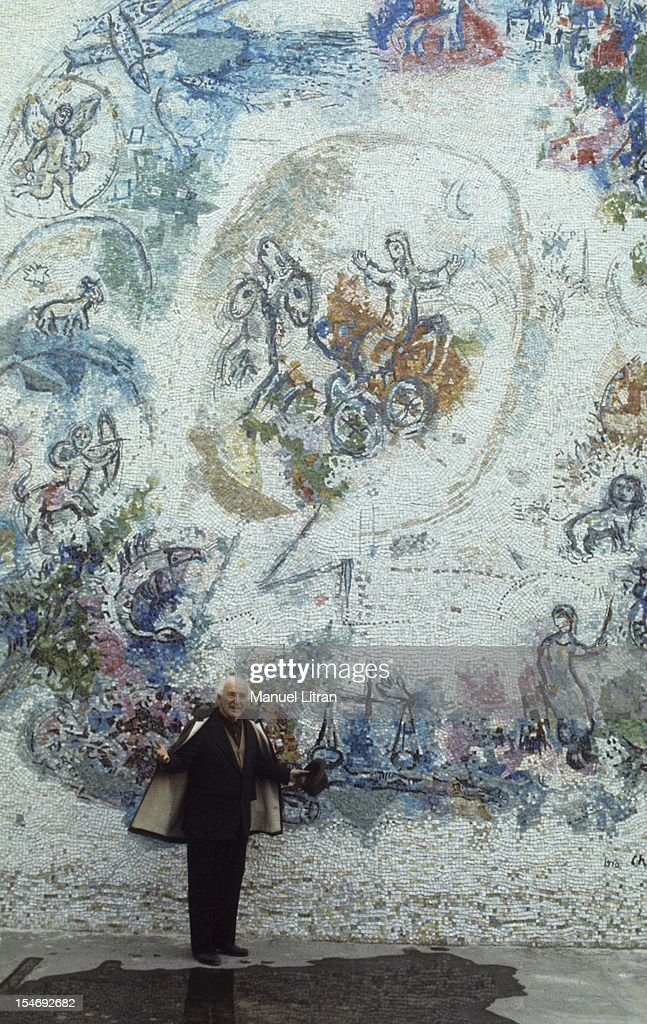 July 1973, the painter <a gi-track='captionPersonalityLinkClicked' href=/galleries/search?phrase=Marc+Chagall&family=editorial&specificpeople=214176 ng-click='$event.stopPropagation()'>Marc Chagall</a> was the occasion of the inauguration of the Musee National Message Bible which is devoted to Nice. He poses in front of the outdoor mosaic 'The Prophet Elijah in his chariot' he had given at the Museum.