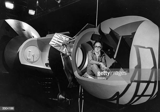 James Burke television populariser of science sits inside the lifesize model of the spacecraft at the BBC TV studio The BBC and Burke planned model...