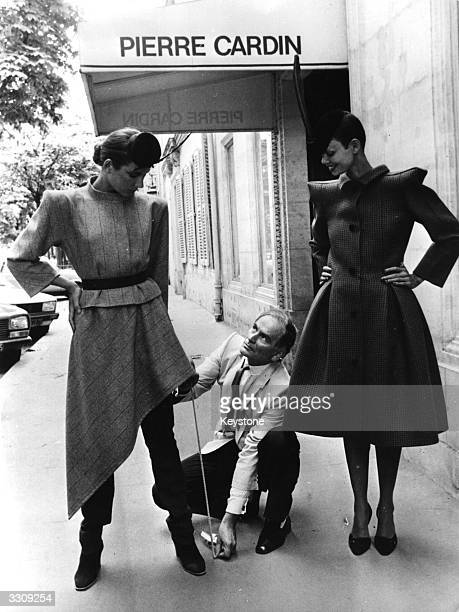 Pierre Cardin French fashion designer with two fashion models
