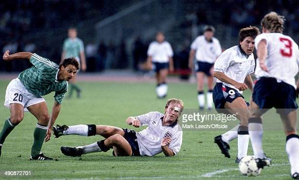 04 July 1990 Football World Cup 1990 England v West Germany Mark Wright of England lays on the floor while Olaf Thon of West Germany goes in search...
