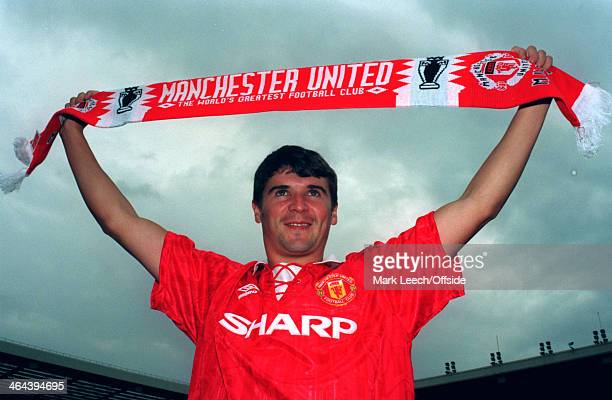19 July 1993 Roy Keane poses in a kit and holds a scarf after signing a contract with Manchester United