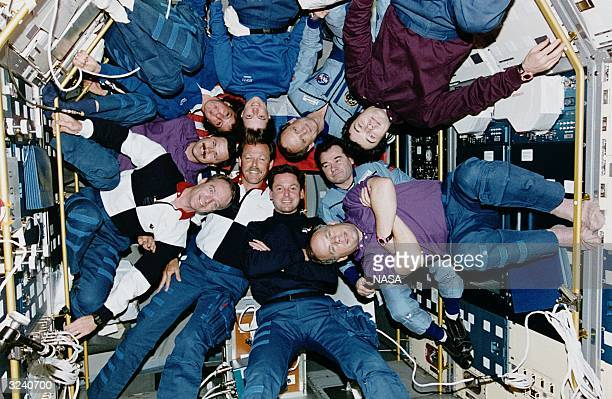 The crew of the Russion Mir missions Mir18 and Mir19 meet the crew of the American shuttle Atlantis mission STS71 inside the Spacelab Science Module...