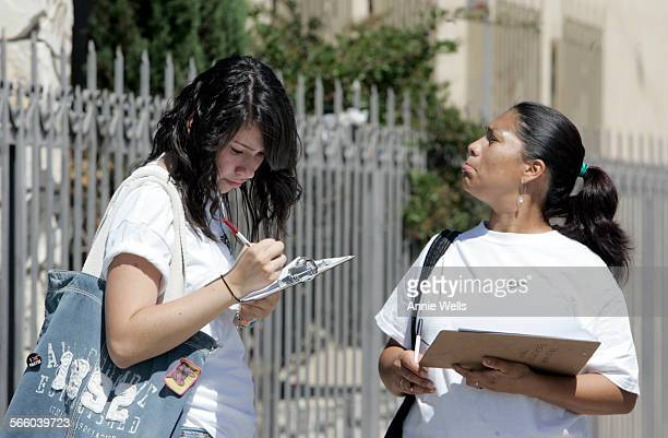 July 2 2008 Sandra Orellana 15 and Marcela Herrera walk along Sutter Street in Pacoima on July 2 and note the businesses on that street they are...
