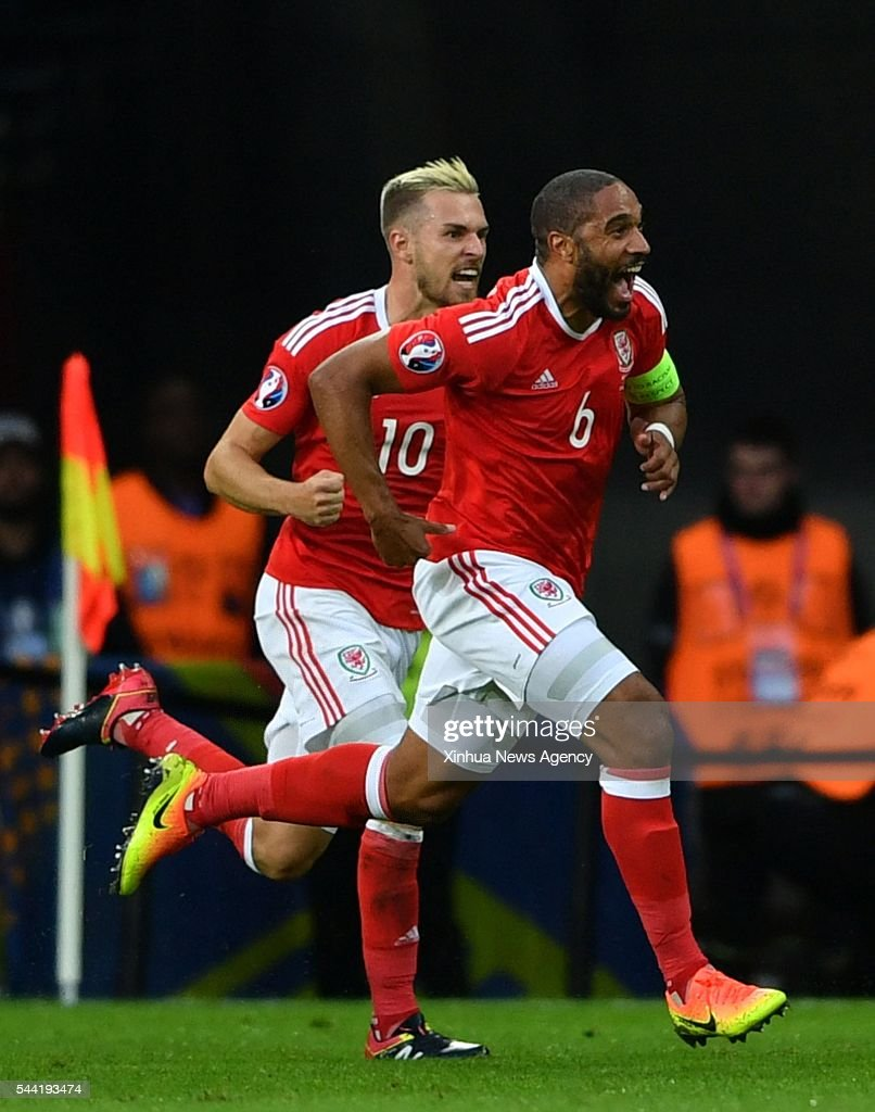 LILLE, July 2, 2016-- Ashley Williams, right, of Wales celebrates after scoring during the Euro 2016 quarterfinal match between Belgium and Wales in Lille, France, July 1, 2016.