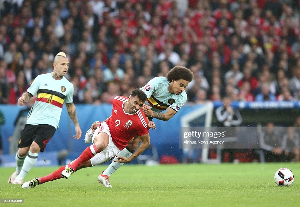 LILLE, July 2, 2016-- Hal Robson-Kanu, front, of Wales vies with Axel Witsel, right, of Belgium during the Euro 2016 quarterfinal match between Belgium and Wales in Lille, France, July 1, 2016.
