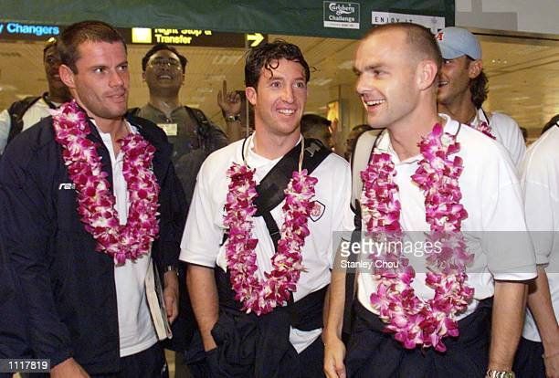 Jamie Carragher Robbie Fowler and Danny Murphy of Liverpool in a cheerful mode upon arrival at the Changi Airport Singapore during Liverpool Team's...
