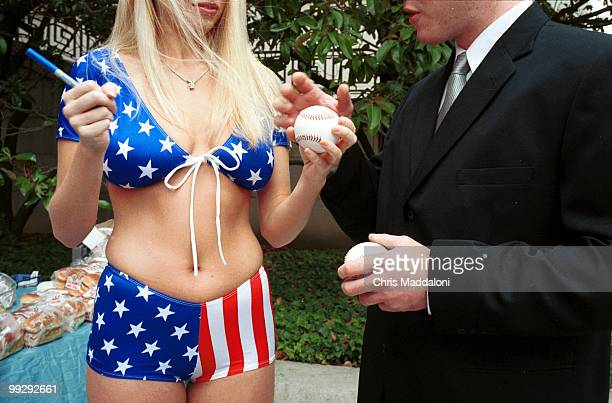 July 2002 Playboy model Lauren Anderson signs baseballs from the American Meat Institute's free hot dog lunch at the People for Ethical Treatment of...