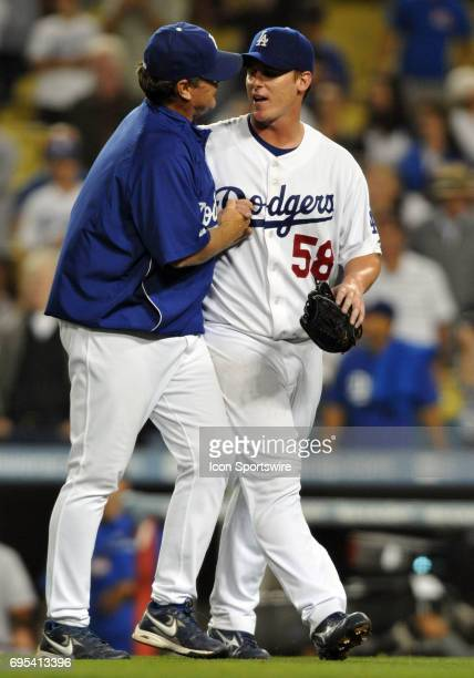 Dodgers Pitching Coach Rick Honeycutt congratulates Dodgers Chad Billingsley after pitching his first career complete game shutout during a Major...