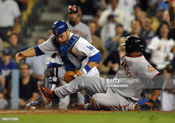Dodgers Russell Martin tags San Francisco Giants Jose Castillo for the final out of the game during a Major League Baseball game between the Los...