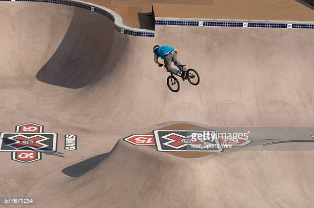Brian Foster floats a 360 over the middle of the BMX Park course The Park Course is half wood half cement The course took five weeks to complete was...