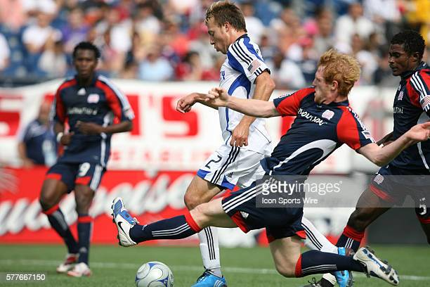 New England's Pat Phelan tries to tackle the ball away from Kansas City's Michael Harrington The New England Revolution played the Kansas City...