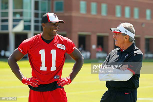 Atlanta Falcons owner Arthur Blank speaks with Atlanta Falcons wide receiver Julio Jones during training camp at Falcons headquarters in Flowery...