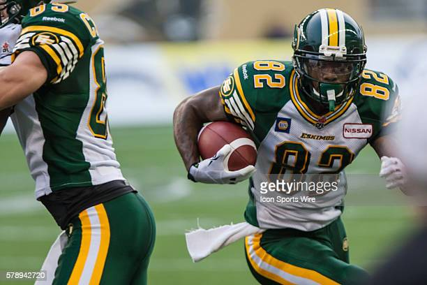 17 July 2014 Eskimos AJ Guyton runs with the ball during the Eskimos vs Bombers game at the Investors Group Field in Winnipeg MB