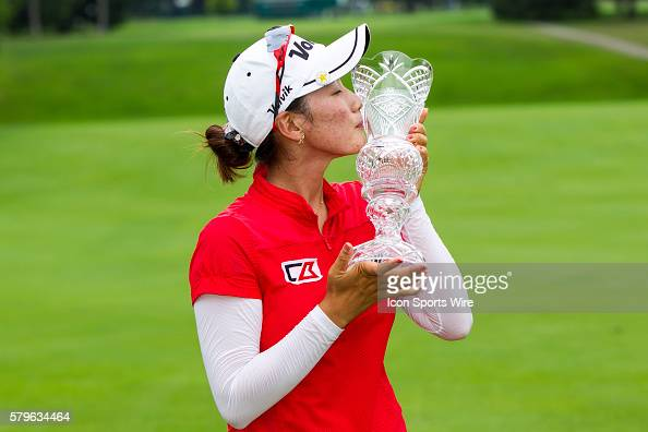 Chella Choi of South Korea kisses the crystal glass trophy after winning her first tournament in a playoff against Ha Na Jang of South Korea during...