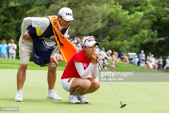 Chella Choi of South Korea lines up her put on the 18th green assisted by her father and caddie Ji Yeon Choi during the final round of the LPGA...