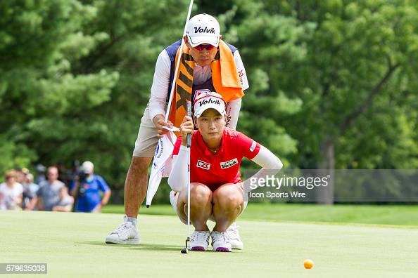 Chella Choi of South Korea lines up her put on the 18th green assisted by her father and caddie Ji Yeon Choi during a playoff hole during the final...
