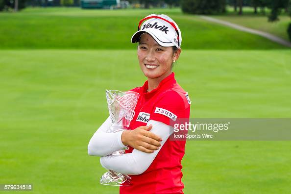 Chella Choi of South Korea poses with the crystal glass trophy after winning her first tournament in a playoff against Ha Na Jang of South Korea...