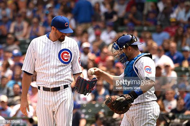 Chicago Cubs starting pitcher Jason Hammel and Chicago Cubs catcher Miguel Montero on the mound during a MLB game between the Miami Marlins and the...