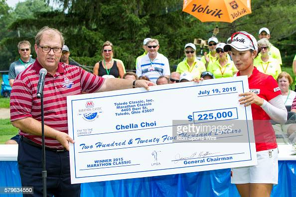 Gary Heminger President and Chief Executive Office of Marathon Petroleum Corporation presents Chella Choi of South Korea with a check after Choi won...