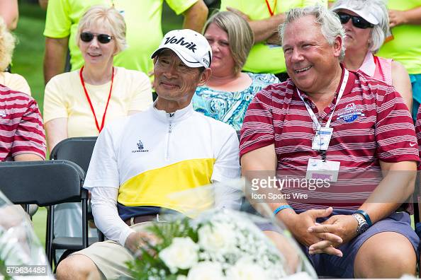 Ji Yeon Choi father and caddie for Chella Choi of South Korea listens to his daughter's acceptance speech after Choi won her first tournament during...
