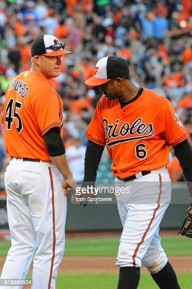 Baltimore Orioles right fielder Mark Trumbo congratulates second baseman Jonathan Schoop following the game against the Los Angeles Angels at Orioles...