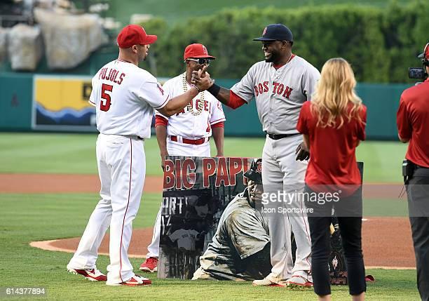 Boston Red Sox Designated hitter David Ortiz [1937] shakes the hand of Los Angeles Angels of Anaheim Designated hitter Albert Pujols [2669] after...