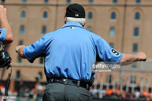First Base umpire Brian Gorman reverses a call after a review at Orioles Park at Camden Yards in Baltimore MD where the Baltimore Orioles defeated...