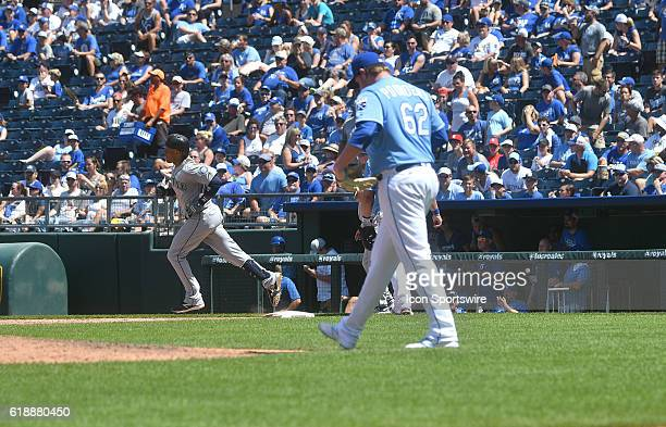 Kansas City relief pitcher Brooks Pounders reacts after Seattle Mariners designated hitter Robinson Cano runs the bases after hitting a tworun home...