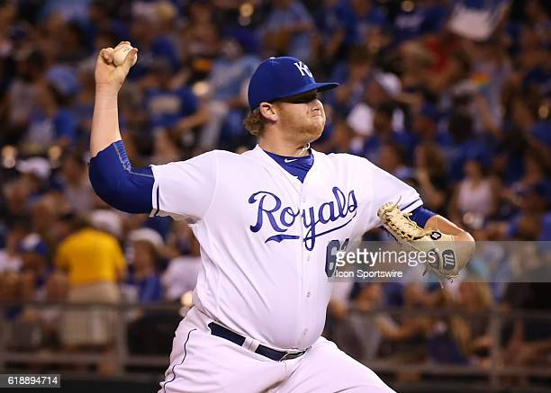 Kansas City Royals relief pitcher Brooks Pounders pitches in the ninth inning and earns his first major league win in a game between the Seattle...