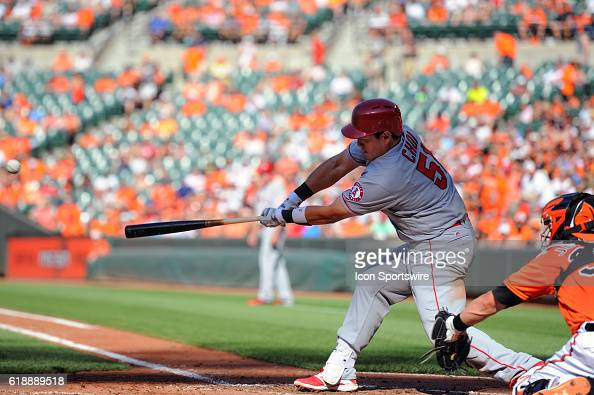 Los Angeles Angels first baseman JiMan Choi strikes out against the Baltimore Orioles at Orioles Park at Camden Yards in Baltimore MD where the...