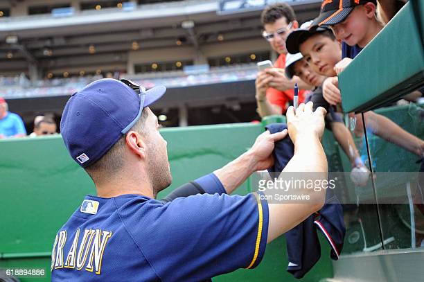 Milwaukee Brewers left fielder Ryan Braun signs an autograph for a fan at Nationals Park in Washington DC where the Washington Nationals defeated the...