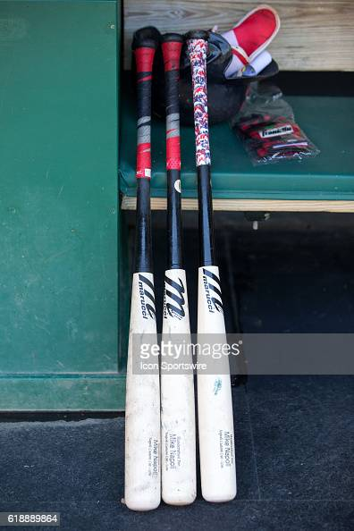 The bats of Cleveland Indians First base Mike Napoli [6085] sit in the dugout prior to the the Major League Baseball game between the New York...