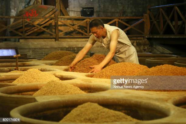 ZHENJIANG July 21 2017 A staff worker processes ingredients at Hengshun Group in Zhenjiang east China's Jiangsu Province July 21 2017 High...
