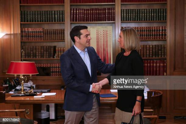 ATHENS July 21 2017 Greek Prime Minister Alexis Tsipras shakes hands with European Union's High Representative for Foreign Affairs and Security...