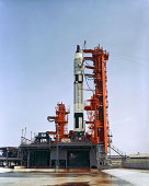 July 22, 1965 - Overall view of Launch Pad 19 showing Gemini-5 spacecraft atop the Gemini Launch Vehicle 5 during a wet mock simulation exercise.