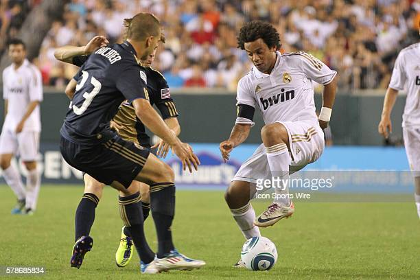 Real Madrids Marcelo Vieira shows fancy footwork as he dribbles past Unions Ryan Richter during the World Football Challenge friendly match between...