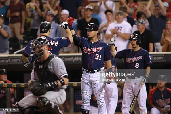 July 25 2014 Minnesota designated hitter Josh Willingham is congratulated by outfielder Oswaldo Arcia and catcher Kurt Suzuki after hitting a home...