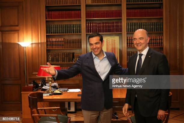 ATHENS July 25 2017 Greek Prime Minister Alexis Tsipras welcomes European Commissioner for Economic and Financial Affairs Pierre Moscovici in Athens...