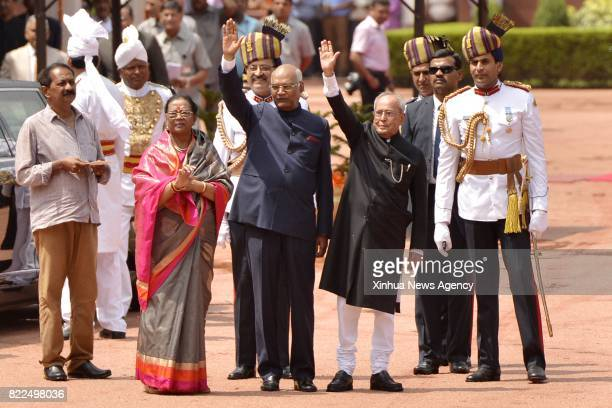 NEW DELHI July 25 2017 Indian newly elected president Ram Nath Kovind and his predecessor Pranab Mukherjee wave at Presidential Palace after the...